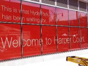 Installation of Window Decals for Harpers Court in Chicago's Hyde Park Neighborhood